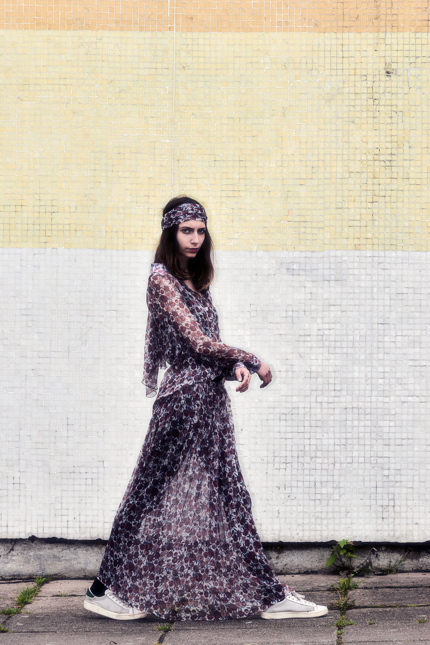"""girl in front of mosaic wall"""