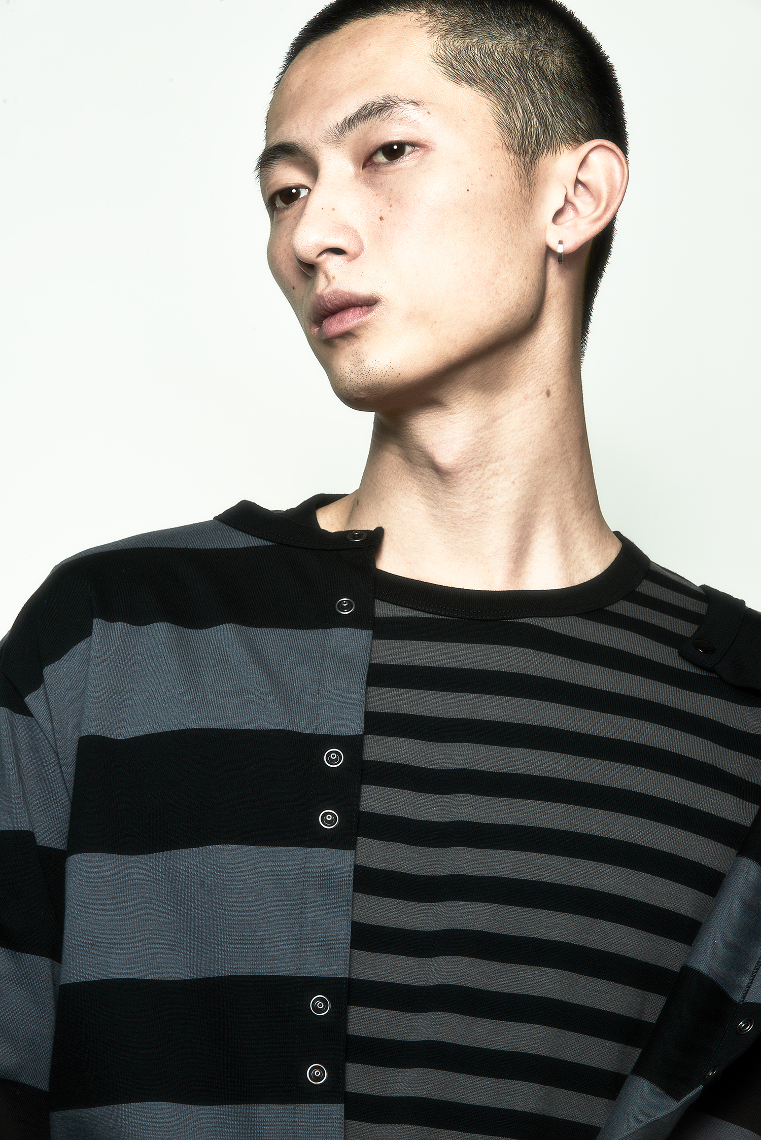 """asian boy with black and grey striped shirt"""
