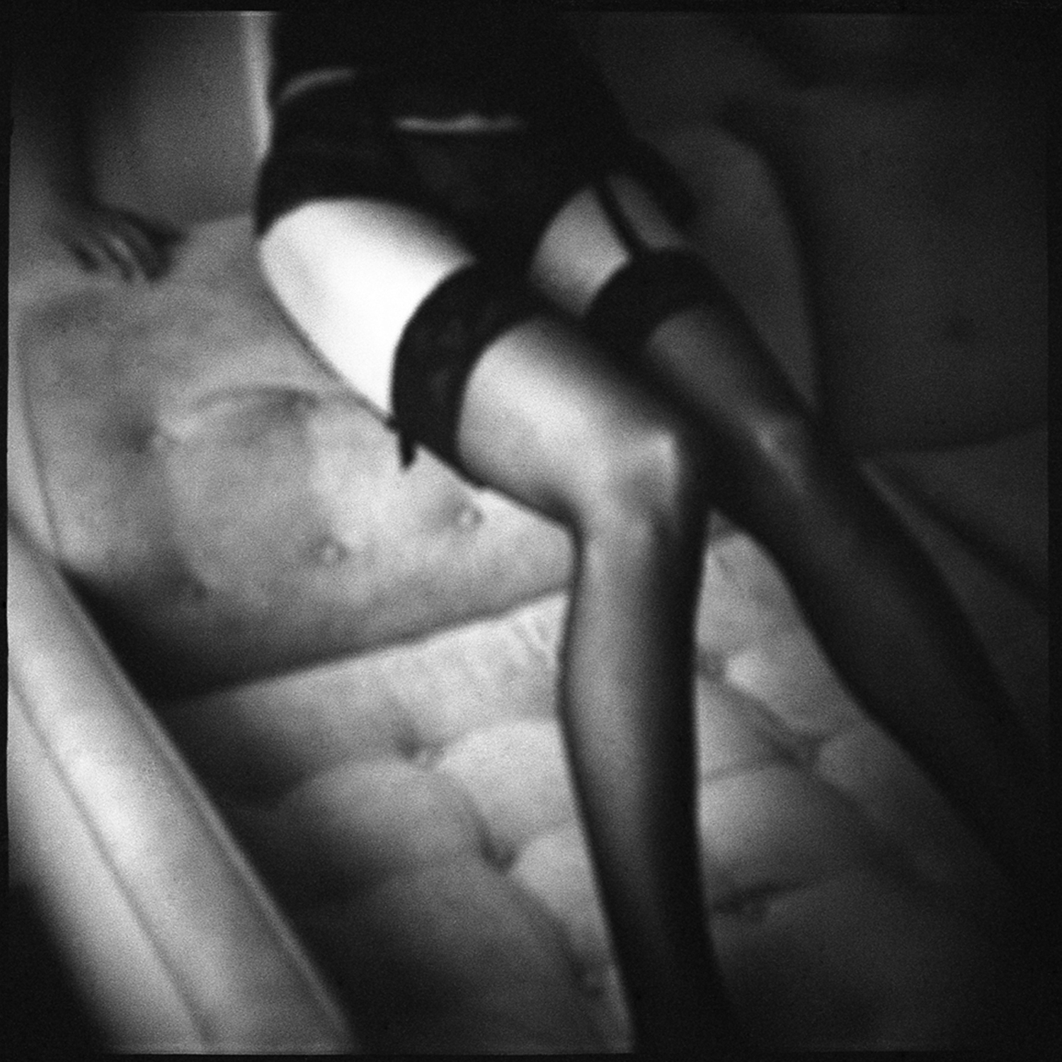 """legs in stockings black and white on couch"""