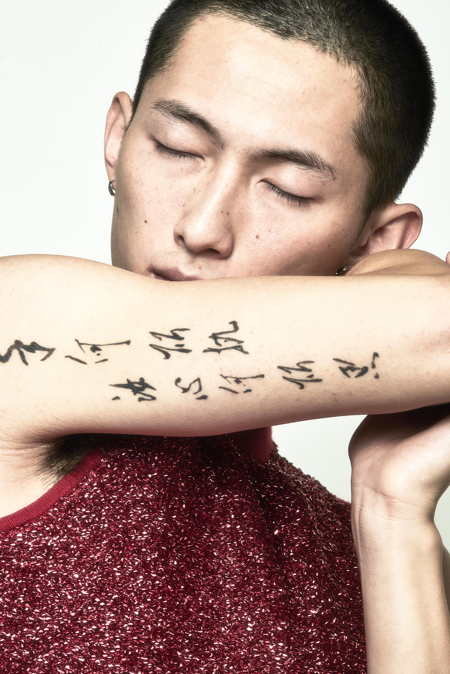 """asian boy with tatoo"""