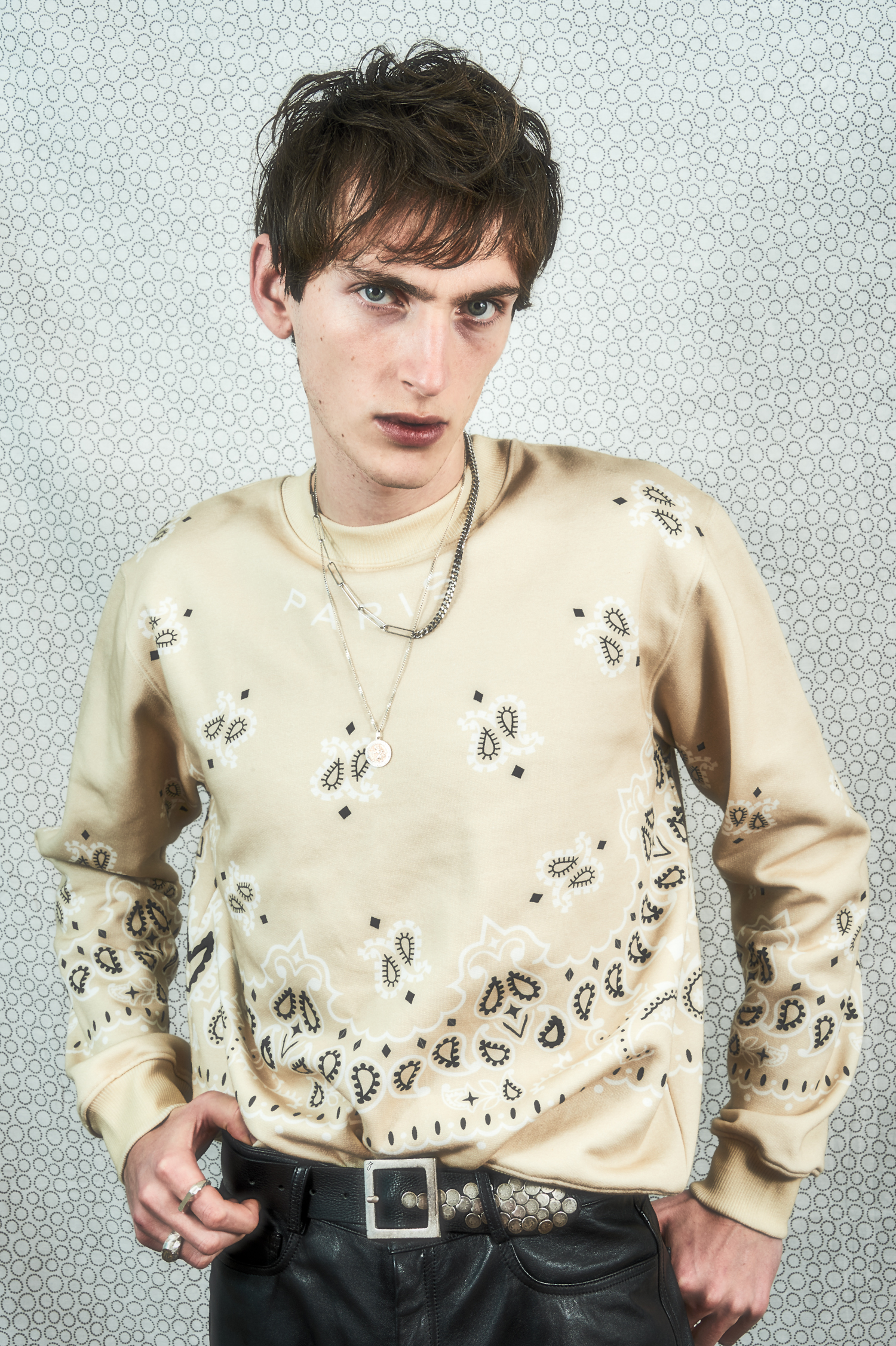 """Portrait of boy in Paisley printed sweat shirt"""