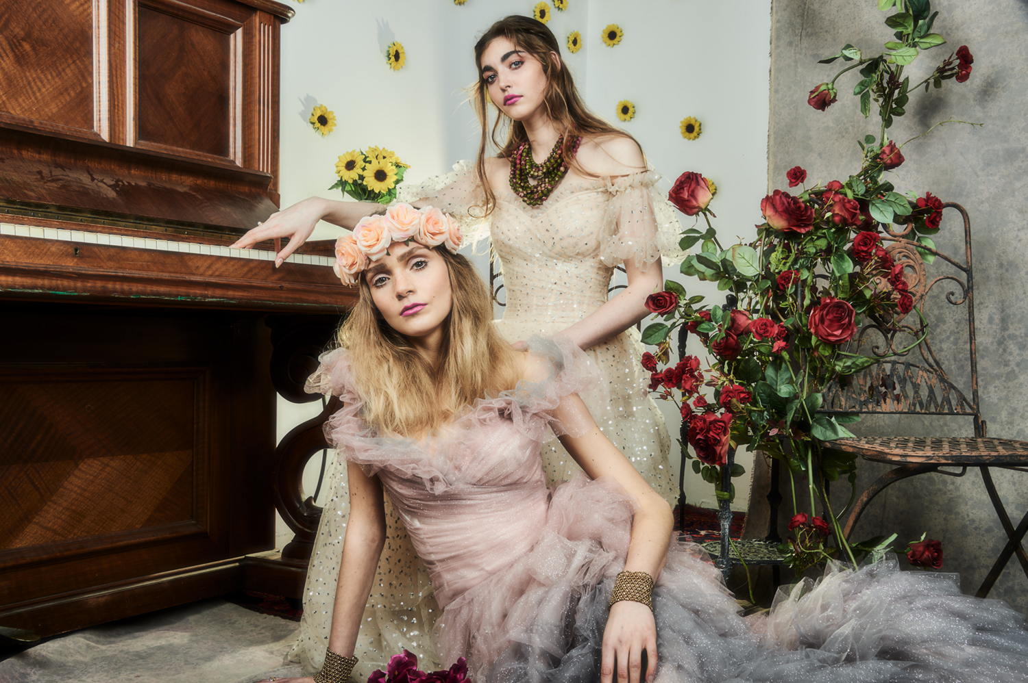 """beautiful hippy styled women in front of piano and roses and sunflowers"""