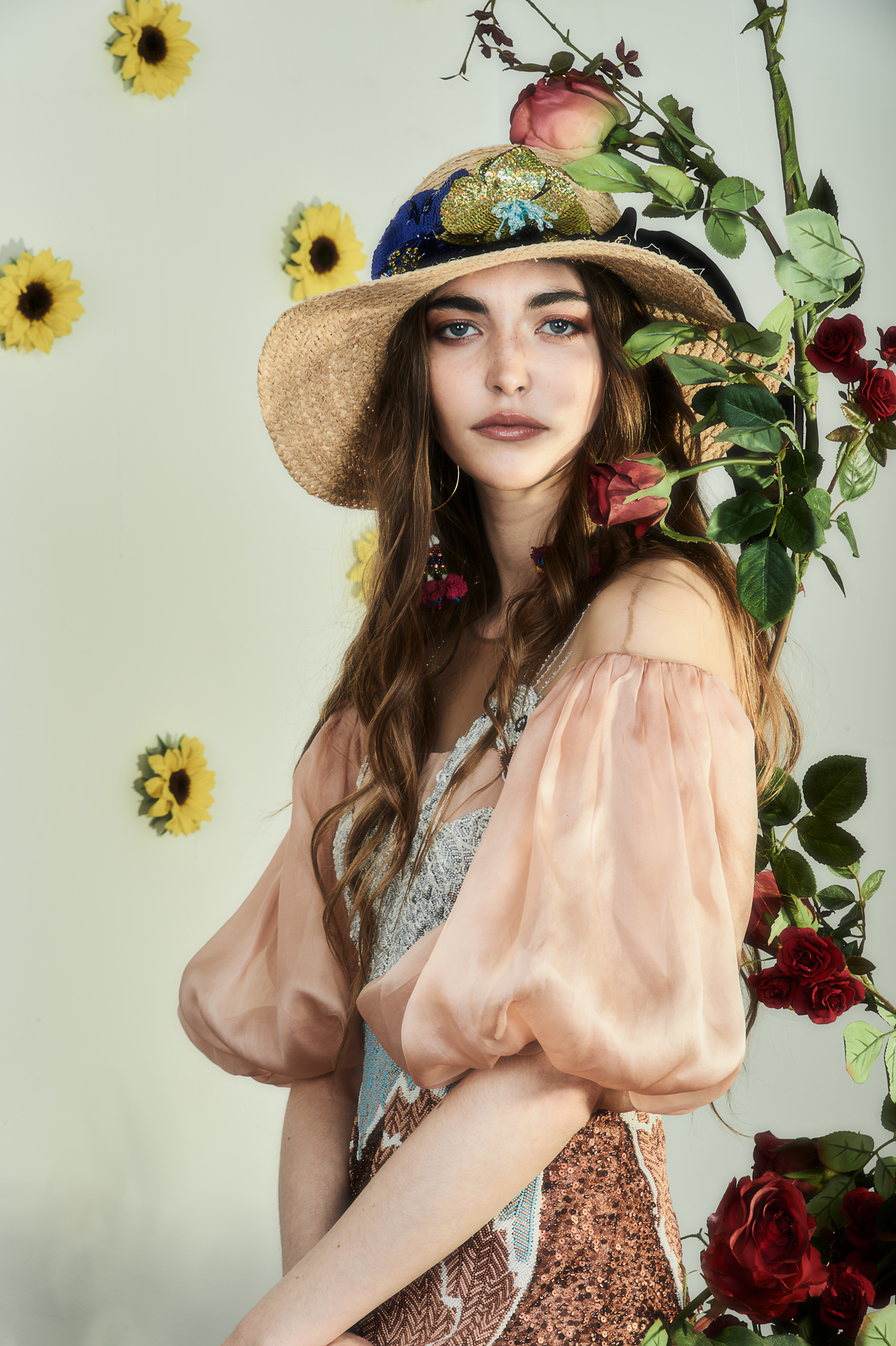 """beautiful hippy styled woman in front of piano and roses and sunflowers"""
