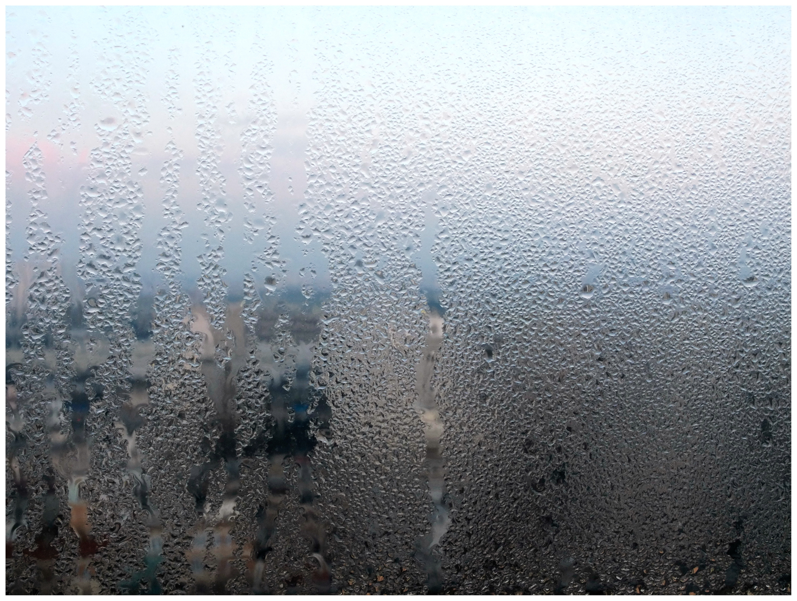 """view rainy Paris from 26th floor"""
