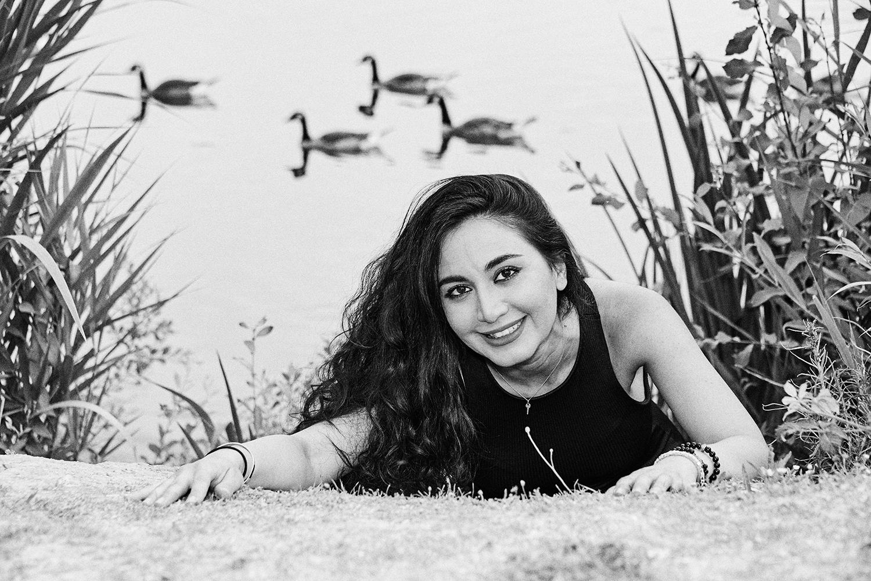 """Black and white portrait of iranian woman at lake"""